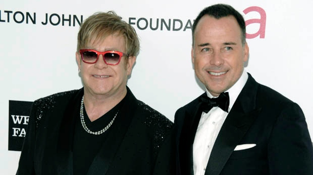 In this Feb. 26, 2012, file photo, Elton John, left, and David Furnish arrive at the Elton John AIDS Foundation Academy Awards viewing party in West Hollywood, Calif. (AP Photo/Dan Steinberg, File)