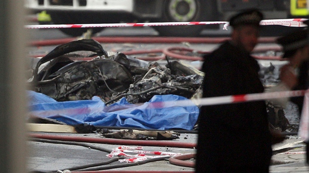 Debris lies on the ground after a helicopter crashed into a construction crane on top of a tower building in London on Wednesday, Jan. 16, 2013. (AP Photo/ Lewis Whyld/PA)