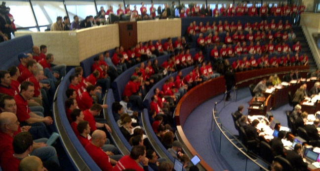 Firefighters fill the chambers at city hall on Wednesday as part of a protest against planned cuts to Toronto Fire Services that are contained in the city's 2013 budget. (George Lagogianes/CP24.com)