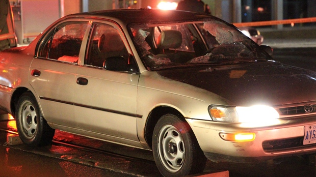 A Toronto police officer was struck by a car at Bathurst and Front streets early Friday, Jan. 18, 2013. (Tom Stefanac/CP24)