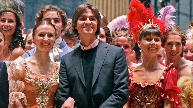 In this Tuesday, Sept. 20, 2011, file photo, Sergei Filin, centre, poses with Bolshoi Theater company members involved in the Sleeping Beauty ballet in Moscow, Russia. (AP Photo/Mikhail Metzel, File)