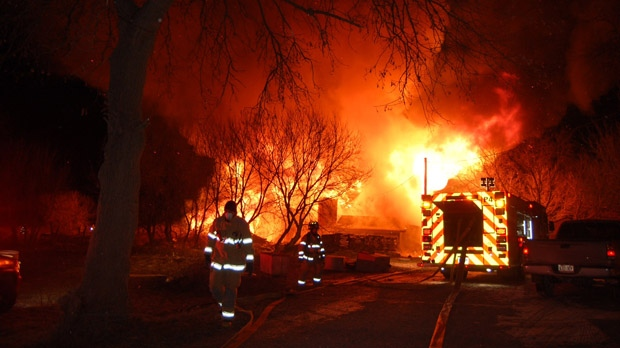 Firefighters battle a barn fire north of Pickering early Wednesday, Jan. 23, 2013. (Tom Stefanac/CP24)