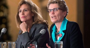 Ontario Liberal party leadership candidate Sandra Pupatello (left) listens as Kathleen Wynne speaks during a forum at Canadian Club of Toronto in Toronto on Thursday December 6, 2012. THE CANADIAN PRESS/Frank Gunn