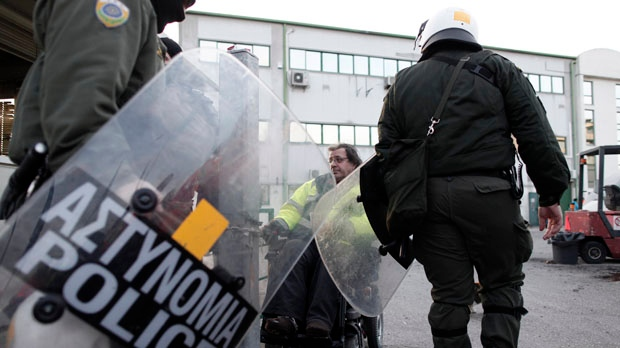 Athens Greece riot police raid subway train depot