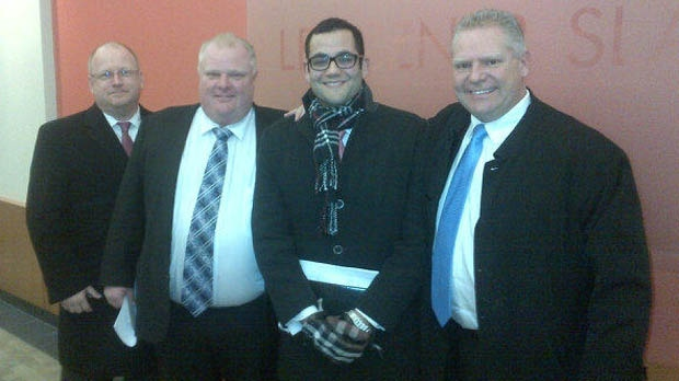 Mayor Rob Ford, second from left, and Coun. Doug Ford, right, pose for a photo taken by George Christopoulos, the mayor's press secretary, after a Divisional Court panel struck down the mayor's conflict-of-interest conviction. (Twitter.com/georgeTdot)