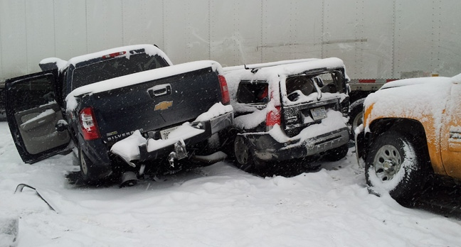 Two vehicles involved in a massive pileup on Highway 401 near Newcastle Friday afternoon are shown alongside a tractor-trailer. (Submitted)