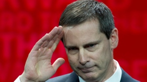 Ontario Premier Dalton McGuinty salutes at the end of his final speech as Premier at the Ontario Liberal Party Leadership convention in Toronto on Friday, Jan. 25, 2013. (The Canadian Press/Frank Gunn)