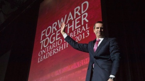 Premier Dalton McGuinty waves to the crowed while leaving the stage after speaking at the Ontario Liberal Leadership convention in Toronto on Friday, Jan. 25, 2013. (The Canadian Press/Nathan Denette)