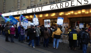 Protesters are shown outside Maple Leaf Gardens, where Ontario Liberals are choosing a new leader today. (Kyle Surowicz/CP24.com)