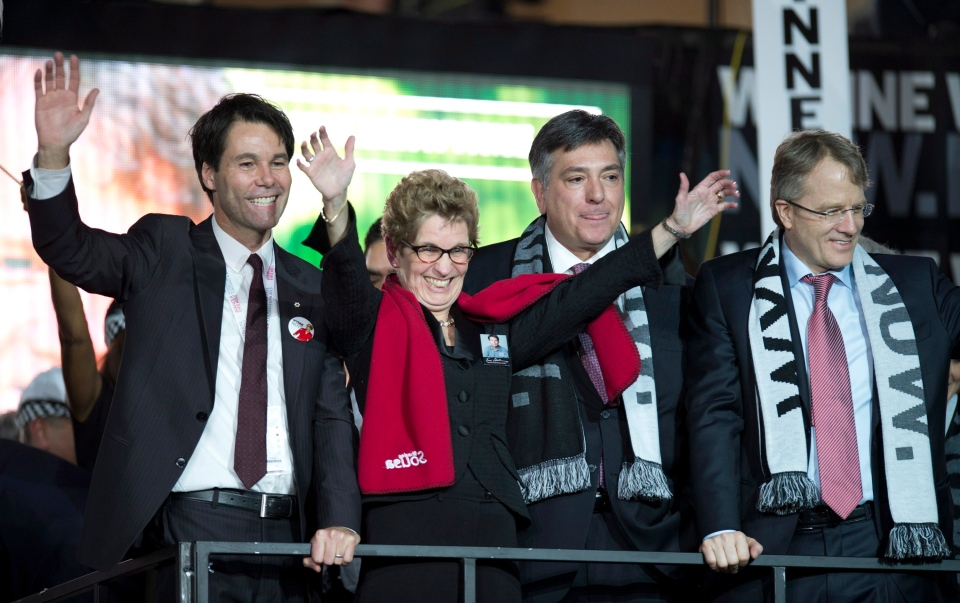 Ontario Liberal Party leadership candidate Kathleen Wynne celebrates with fellow candidates Eric Hoskins (left), Gerard Kennedy (right) and Charles Sousa after they gave her their support at the convention in Toronto on Saturday January 26, 2013. (THE CANADIAN PRESS/ Frank Gunn)