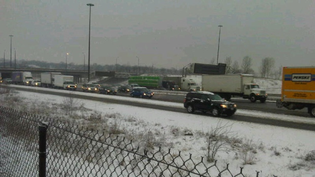 Motorists make their way along eastbound Highway 401, near Highway 400, as they contend with snow on Monday, Jan. 28, 2013. (Cam Woolley/CP24)