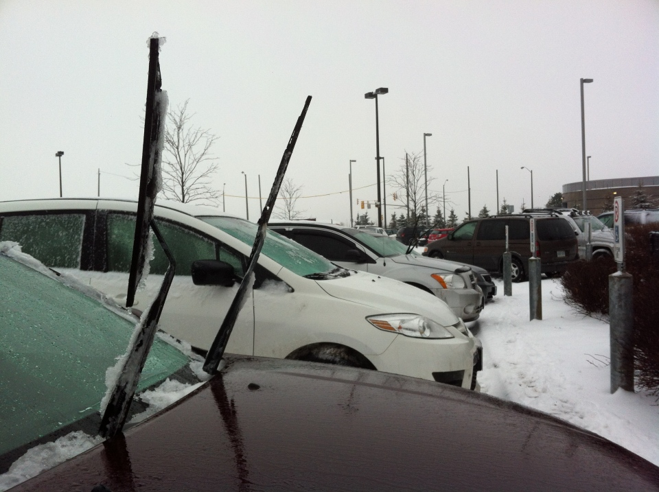 Commuters at a Downsview Station parking lot leave their windshield wipers propped up in anticipation of freezing rain in Toronto Monday, January, 28, 2013. (CP24/ Joshua Freeman)