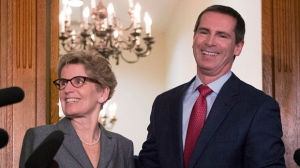Outgoing Premier Dalton McGuinty, right, and premier-designate Kathleen Wynne pose for the media after a meeting at Queen's Park in Toronto on Monday, Jan. 28, 2013. (The Canadian Press/Chris Young)