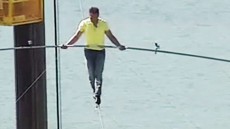 Famed tightrope walker Nik Wallenda walks on a wire 200 feet over U.S. 41 in Sarasota, Fla., without a safety harness on Tuesday, Jan. 29, 2013.