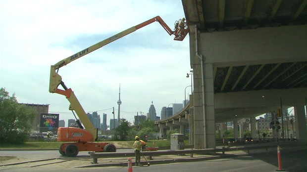 City of Toronto employees conduct repairs on the Gardiner Expressway.