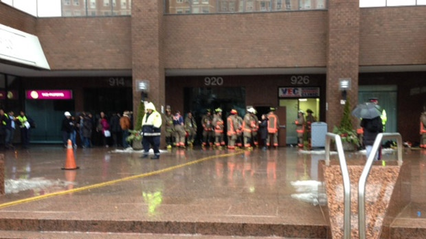Firefighters gather outside a Yonge Street apartment building after a fire Wednesday, Jan. 30, 2013. (Cam Woolley/CP24)