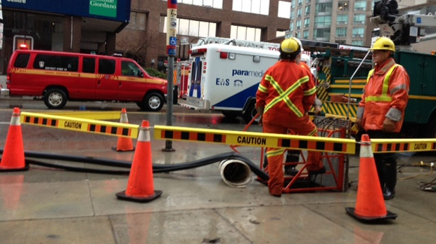 Toronto Hydro employees pump water out of the flooded basement of a Yonge Street apartment building after a water main break and fire Wednesday, Jan. 30, 2013. (Cam Woolley/CP24)