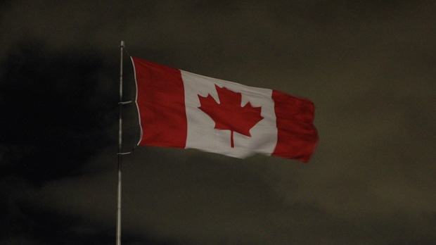 A Canadian flag is whipped by strong winds in Toronto early Thursday, Jan. 31, 2013. (Tom Stefanac/CP24)