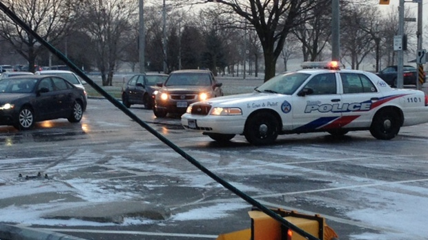 Police block Lake Shore Boulevard's westbound lanes at Ellis Avenue after a car crashed into a pole as icy roads created problems for motorists Thursday, Jan. 31, 2013. (Cam Woolley/CP24)