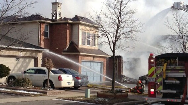 Firefighters battle a blaze on Beaconsfield Avenue in Brampton on Friday, Feb. 1, 2013. (Tamara Cherry/CTV)