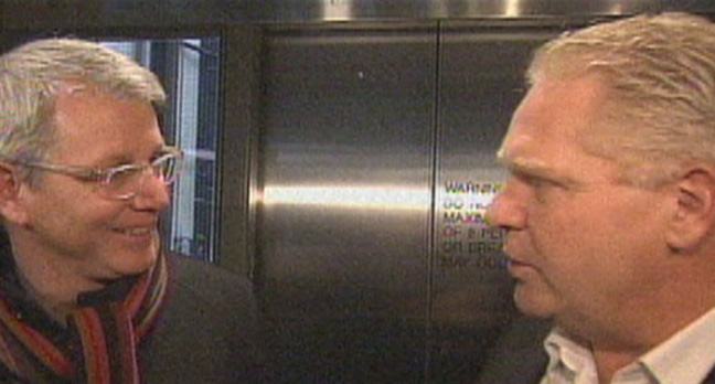 Councillors Adam Vaughan and Doug Ford exchange words inside city hall Friday.