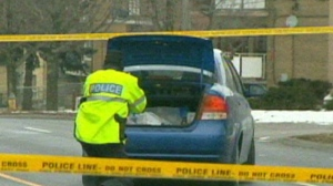 A police officer is shown at the scene of an accident on Birchmount Road Saturday afternoon.