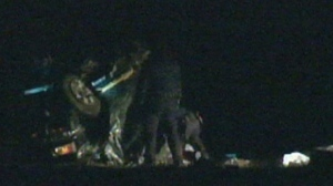 Police are shown examining a vehicle involved in a fatal rollover in Pickering late Saturday night.
