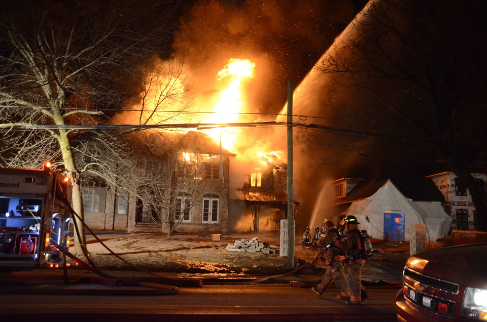 A fire at a house under construction on Lakeshore Road in Burlington is seen in this photo on Tuesday, Feb. 5, 2013. (Andrew Collins)