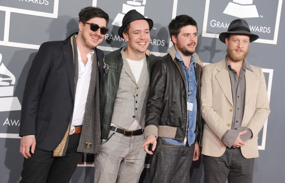 From left, Marcus Mumford, Ben Lovett, Country Winston and Ted Dwane, of musical group Mumford & Sons, arrive at the 55th annual Grammy Awards in Los Angeles on Sunday, Feb. 10, 2013. (AP / Jordan Strauss)