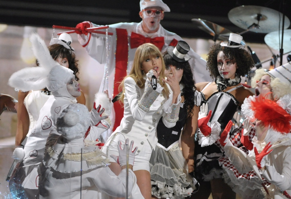 Taylor Swift performs on stage at the 55th annual Grammy Awards on Sunday, Feb. 10, 2013, in Los Angeles. (AP Photo/ Invision /John Shearer)