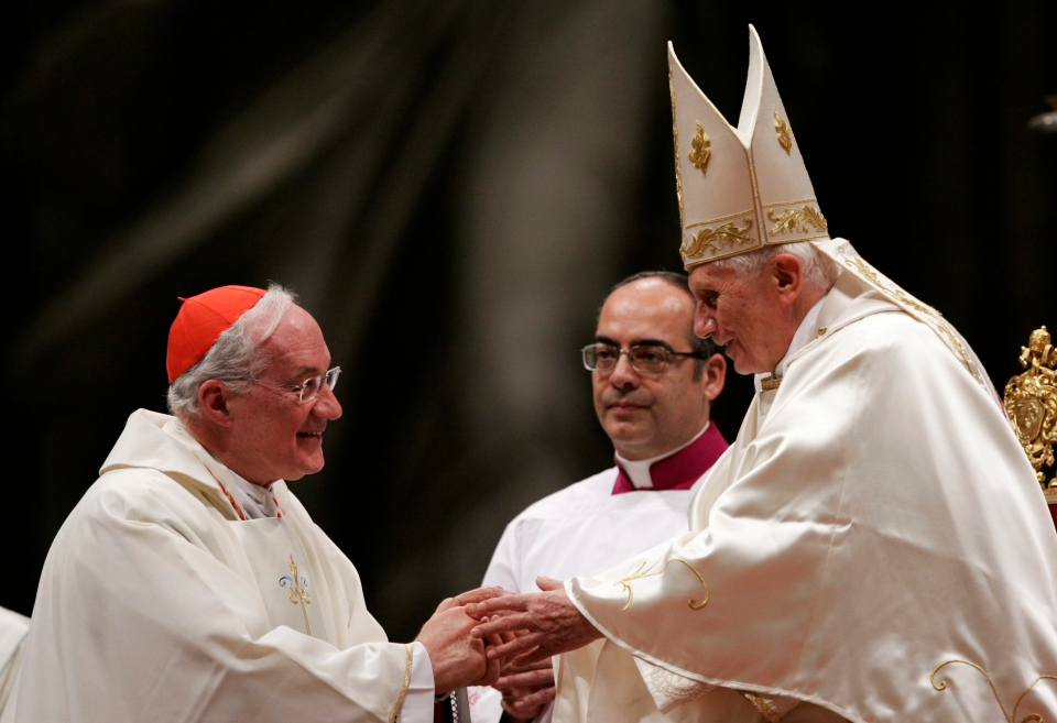 Pope Benedict XVI, right, greets Cardinal Marc Ouellet of Canada, at the beginning of a mass for Latin America in St. Peter's Basilica at the Vatican on Monday, Dec. 12, 2011. (AP Photo/Riccardo De Luca)
