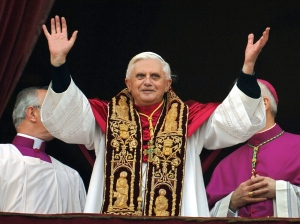 This April 19, 2005 file photo shows Pope Benedict XVI greeting the crowd from the central balcony of St. Peter's Basilica moments after being elected at the Vatican. (AP Photo/Domenico Stinellis/FILE)
