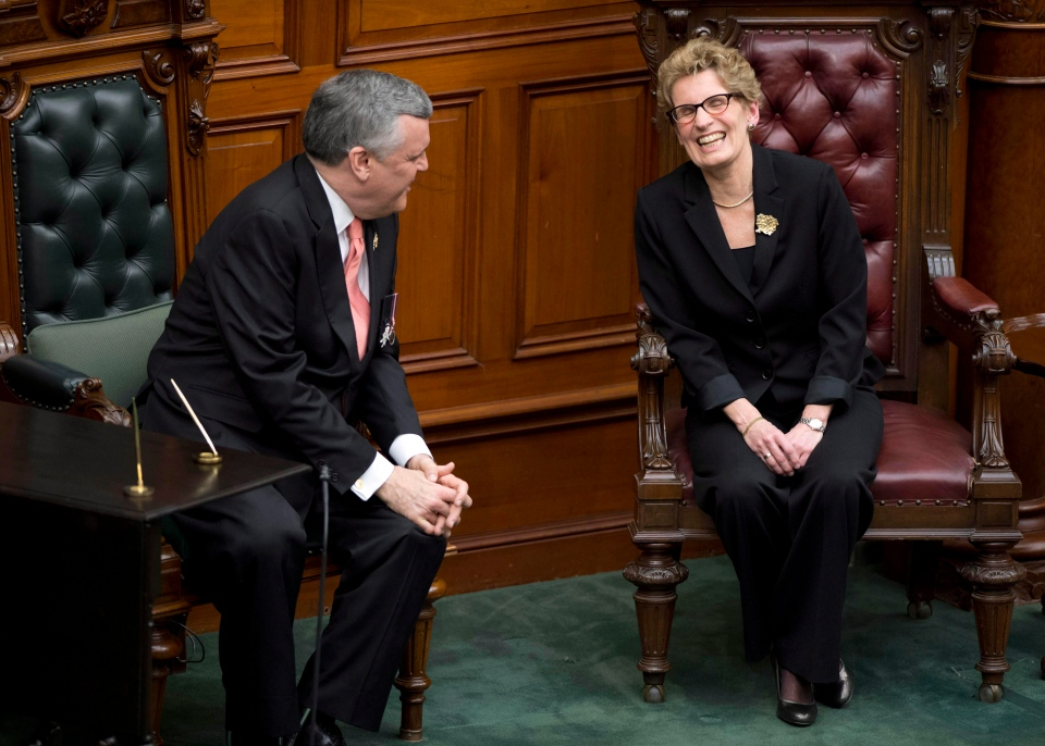 Ontario Premier Kathleen Wynne shares a laugh with Ontario Lieutenant Governor David Onley during her swearing in ceremony in Toronto on Monday, Feb. 11, 2013. (Frank Gunn/The Canadian Press)