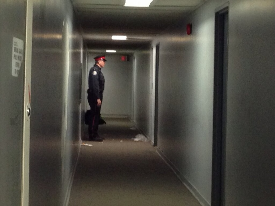 A Toronto police officer guards an apartment suite Tuesday, Feb. 12, 2013, after a teen was fatally shot. (Tamara Cherry/CTV)