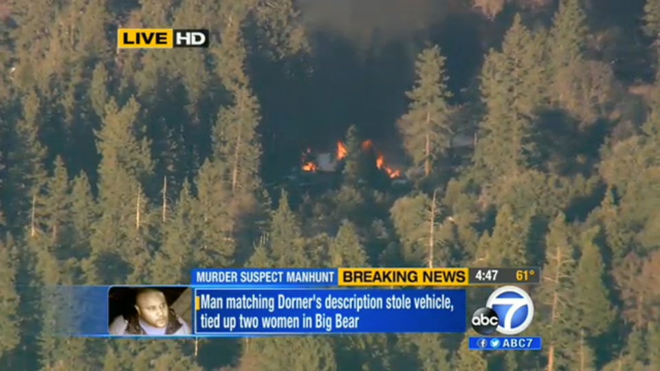 In this image taken from video provided by KABC-TV, the cabin in Big Bear, Calif. where ex-Los Angeles police officer Christopher Dorner is believed to be barricaded inside is in flames Tuesday, Feb. 12, 2013. (AP Photo/KABC-TV)