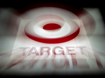 In this Nov. 16, 2010 photpo, a zoom lens creates an interesting effect on this photo of one of the signs on the Target store in Montgomery, Ala. Target is expanding North, agreeing Thursday, Jan. 13, 2011, to acquire most leases of Canadian mass-merchant chain Zellers and planning to open its first Canadian stores in 2013.(AP Photo/Dave Martin)