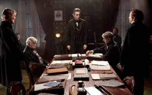 """This undated publicity photo released by Walt Disney Pictures shows Daniel Day-Lewis, centre rear, as Abraham Lincoln in a scene from the film """"Lincoln."""" (AP Photo/Disney-DreamWorks II, David James)"""