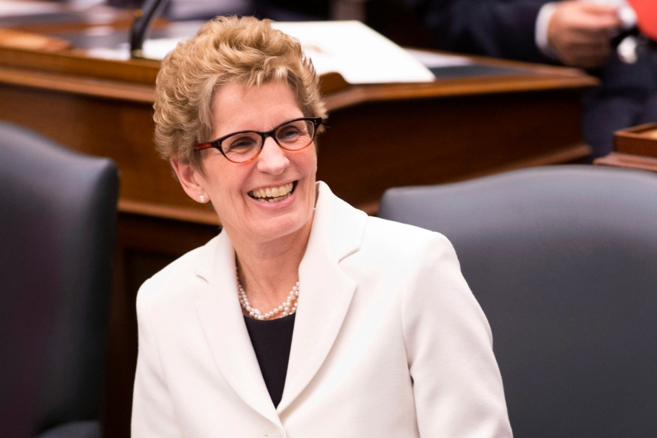 Ontario Premier Kathleen Wynne reacts as Lieutenant Governor David Onley delivers the throne speech at the Ontario Legislature in Toronto on Tuesday, Feb. 19, 2013, (The Canadian Press/Chris Young)