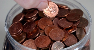 A household penny jar is shown in Montreal, Monday, February 4, 2013. THE CANADIAN PRESS/Ryan Remiorz