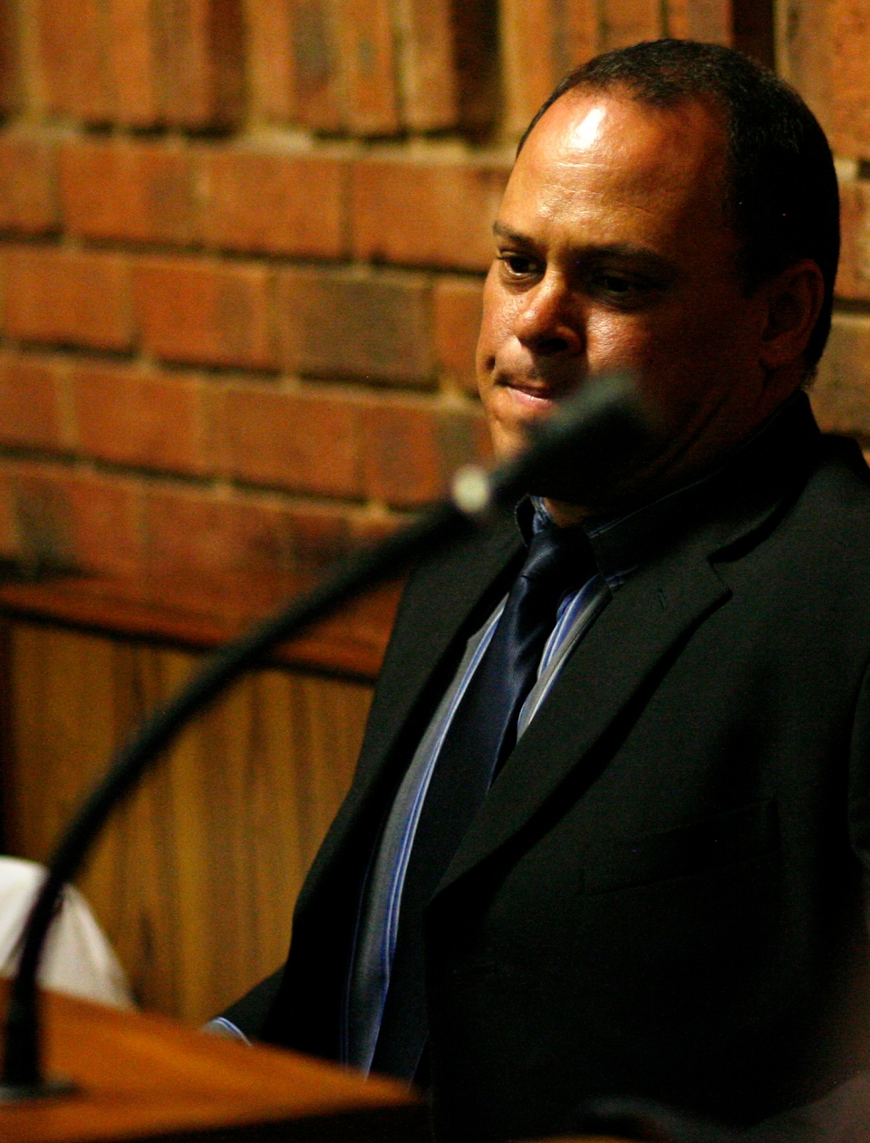 Investigating officer Hilton Botha sits inside the witness box during a bail hearing for Oscar Pistorius at the magistrate court in Pretoria, South Africa on Thursday, Feb. 21, 2013. (AP Photo/Themba Hadebe)