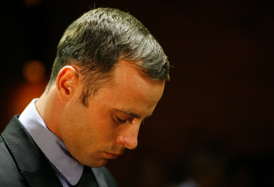 Olympic athlete Oscar Pistorius stands during his bail hearing at the magistrate court in Pretoria, South Africa on Thursday, Feb. 21, 2013. (AP Photo/Themba Hadebe)