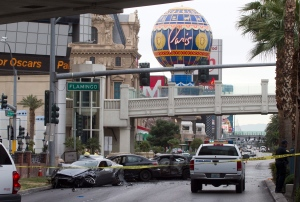 Police rope off the scene of a shooting and multi-car crash on the Las Vegas Strip in Las Vegas early Thursday, Feb. 21, 2013. (AP Photo/Las Vegas Sun, Steve Marcus)