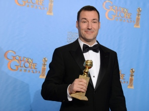 """Director Mark Andrews poses with the award for best animated feature film for """"Brave"""" at the 70th annual Golden Globe Awards at the Beverly Hilton Hotel on Sunday, Jan. 13, 2013, in Beverly Hills, Calif. (Photo by Jordan Strauss/Invision/AP)"""