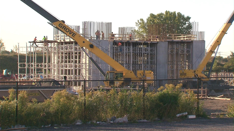 Workers are pictured at one of two cancelled gas plants in the GTA in this file photo.