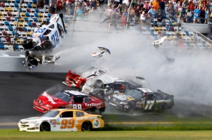 Kyle Larson (32) goes into the catch fence during a crash at the conclusion of the NASCAR Nationwide Series auto race Saturday, Feb. 23, 2013, at Daytona International Speedway in Daytona Beach, Fla.  (AP /Terry Renna)