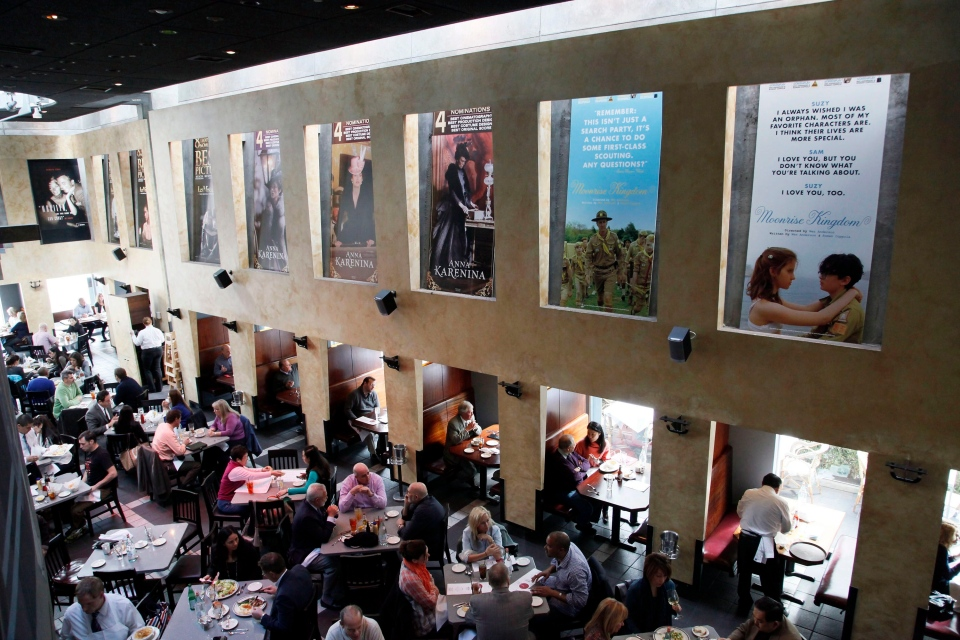 This Thursday, Feb. 21, 2013 photo shows people having lunch beneath Oscar posters at Kate Mantilini restaurant in Beverly Hills, Calif. The 85th Academy Awards are held on Sunday, Feb. 24, 2013, in Los Angeles. (AP /Nick Ut)