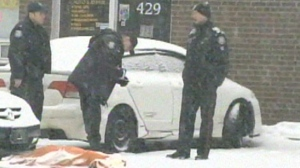 Police are shown at the scene of a homicide near Finch Avenue and Highway 400 on February 24, 2013.