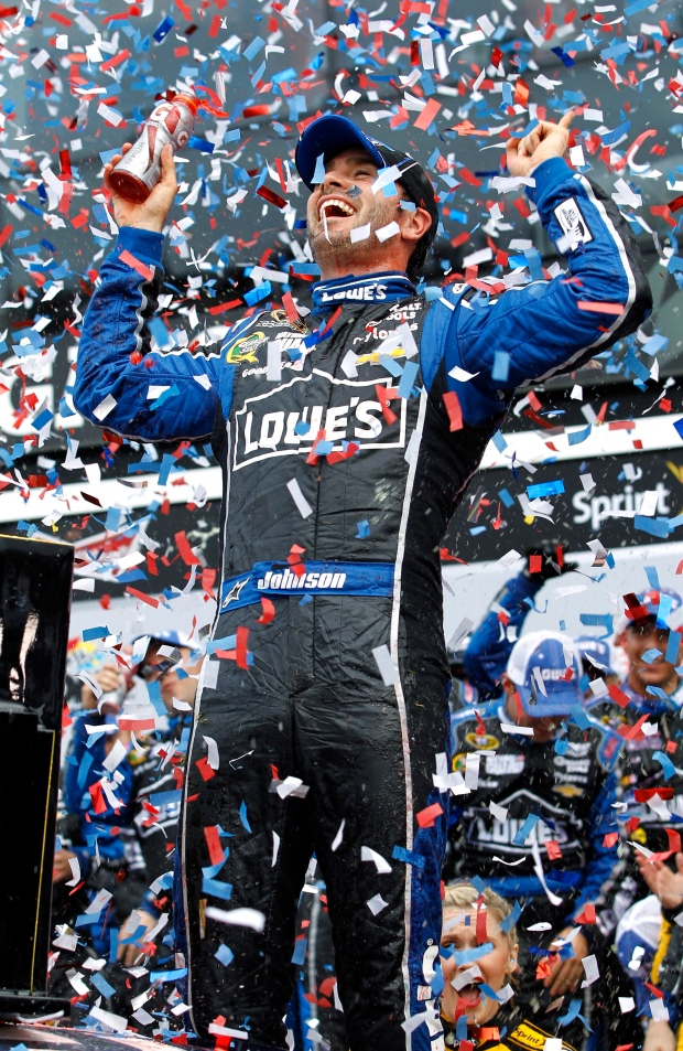 Jimmie Johnson celebrates after winning the Daytona 500 NASCAR Sprint Cup Series auto race, Sunday, Feb. 24, 2013, at Daytona International Speedway in Daytona Beach, Fla. (AP /Terry Renna)