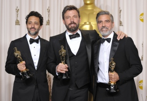 "Grant Heslov, from left, Ben Affleck and George Clooney pose with their award for best picture for ""Argo"" during the Oscars at the Dolby Theatre in Los Angeles on Sunday, Feb. 24, 2013. (AP/ Invision/ John Shearer)"