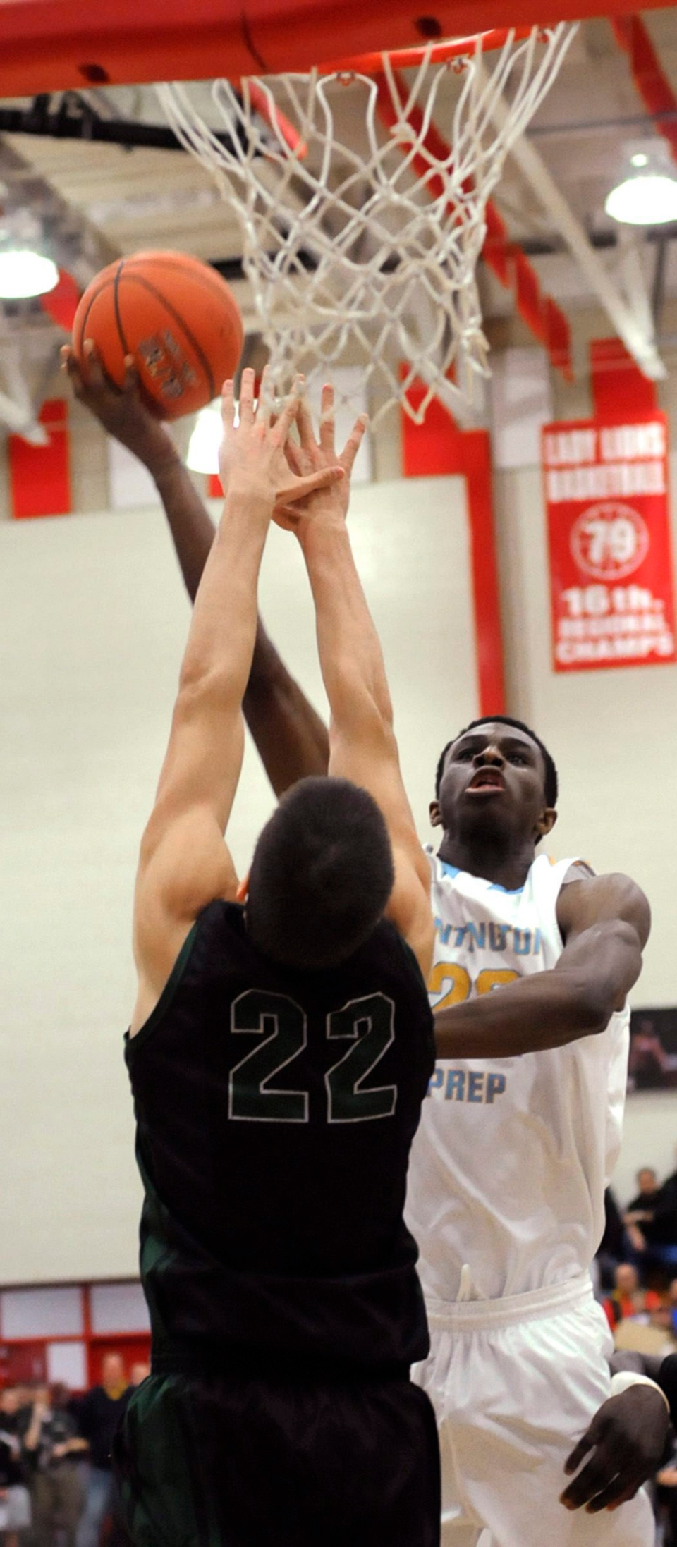 Huntington (WV) Prep's Andrew Wiggins puts up a shot over Nikola Jovanovic of Arlington Country Day (FLA) during the first quarter of their game in the Boyd County Roundball Classic basketball tournament in Summit, Ky., on Saturday, Dec. 15, 2012. (AP Photo/The Independent, Kevin Goldy)
